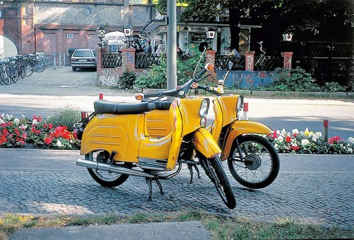 Photograph from Gabriel Orozcos series Until You Find Another Yellow Schwalb 1995 two yellow Schwalb scooters side by side