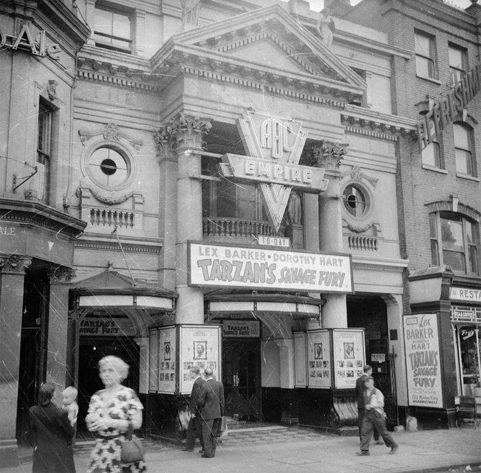 black and white photograph of a street scene of ABC empire theatre in the late 1940s early 50s
