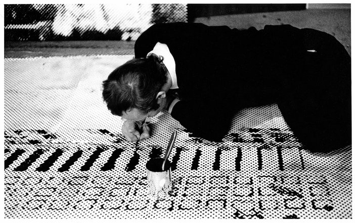Sigmar Polke working in his studio on Front of the Housing Block (Häuserfront), 1967