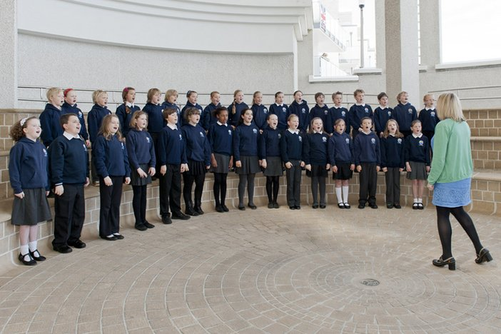 A children's choir sing for the The Queen and the Duke of Edinburgh during their visit to Tate St Ives on Friday 17th May 2013