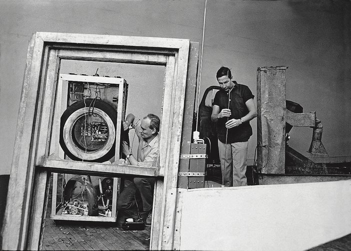Rauschenberg and Billy Klüver working on 'Oracle' 1962–5 in Rauschenberg's Broadway studio, New York, 1965