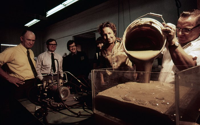 Rauschenberg viewing a prototype for his piece 'Mud Muse' 1970 with engineers from Teledyne and LACMA curators Maurice Tuchman and Gail Scott