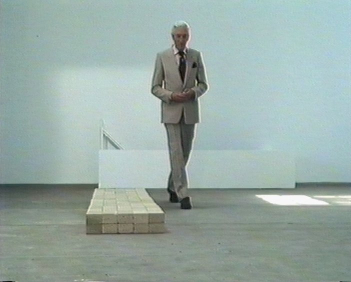Raymond Baxter with Carl Andre's Equivalent VIII in Upholding The Bricks, screened in 1991