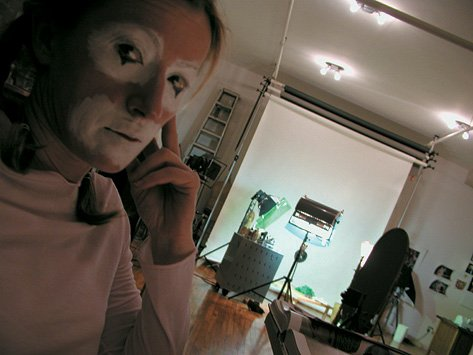 Cindy Sherman Diagonal shot of Sherman in clown face in her studio