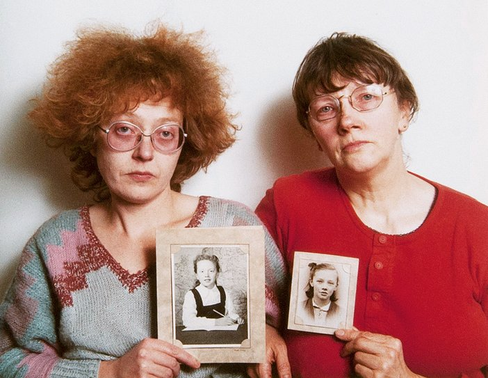 Rosy Martin and Jo Spence undertaking a photo therapy session using childhood portraits from their family albums