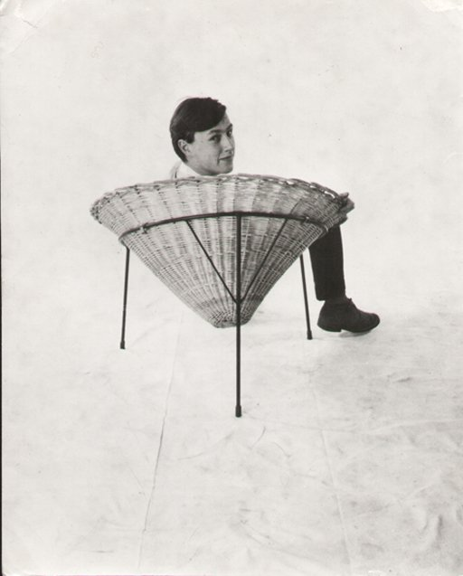 Terence Conran in one of his chairs circa 1950