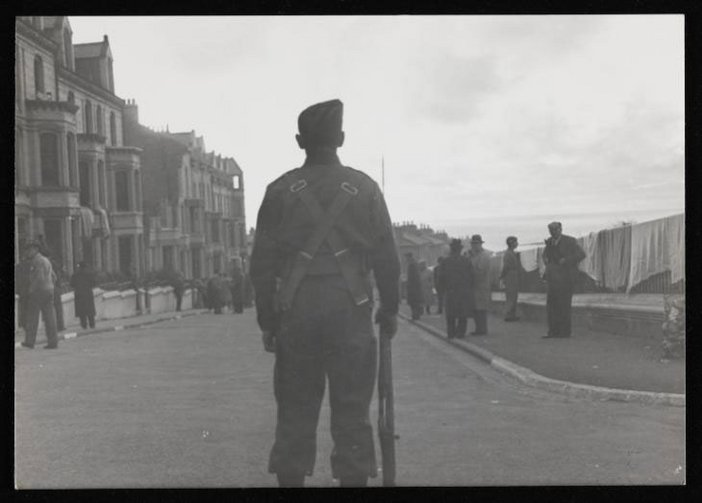 Black and white photograph of a soldier at Hutchinson Internment Camp