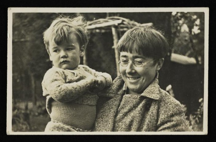 Black and white photograph of artist Felicia Browne holding a child