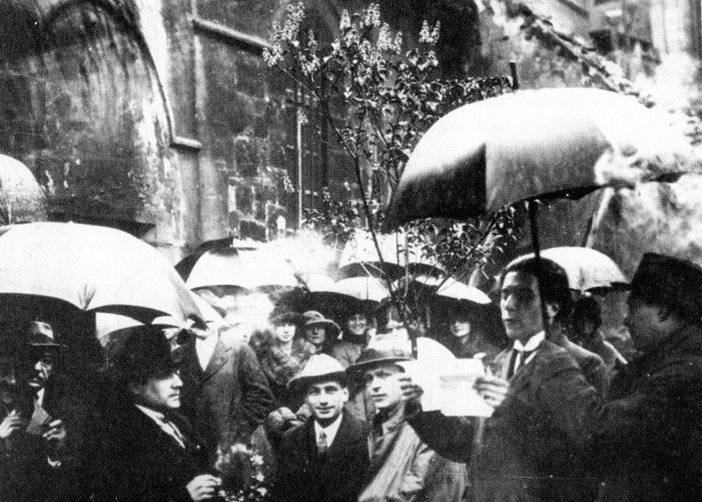 Tristan Tzara reading to the crowd at St Julien le Pauvre church Paris