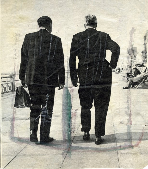 Magazine cutting of unidentified men from Francis Bacons archive two men in suits walking along the sea front