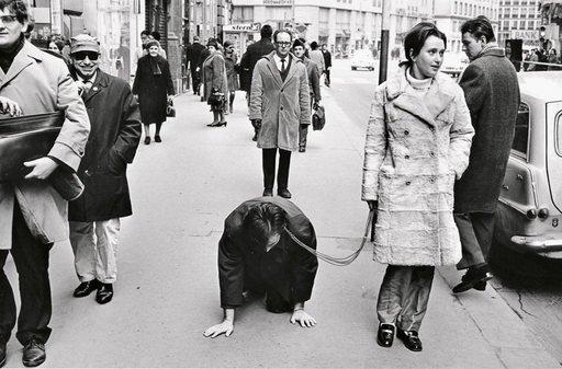VALIE EXPORT walks Peter Weibel on a leash in the performance Aus der Mappe der Hundigkeit From the Portfolio of Doggishness Vienna 1968