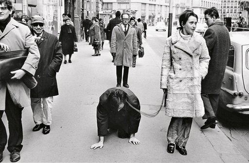 VALIE EXPORT walks Peter Weibel on a leash in the performance Aus der Mappe der Hundigkeit From the Portfolio of Doggishness Vienna 1968