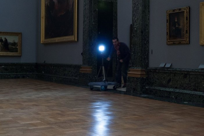 The Workers filming in the galleries at night