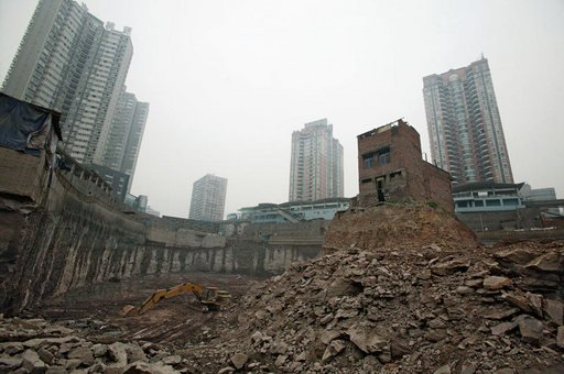 Wu Pings house in Chongqing China after she refused to move for a property project in 2007 a photograph of a lone house in the middle of demolition site