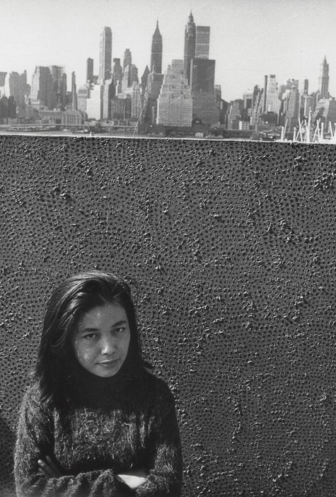 Yayoi Kusama with one of her Infinity Net paintings in New York, c.1961