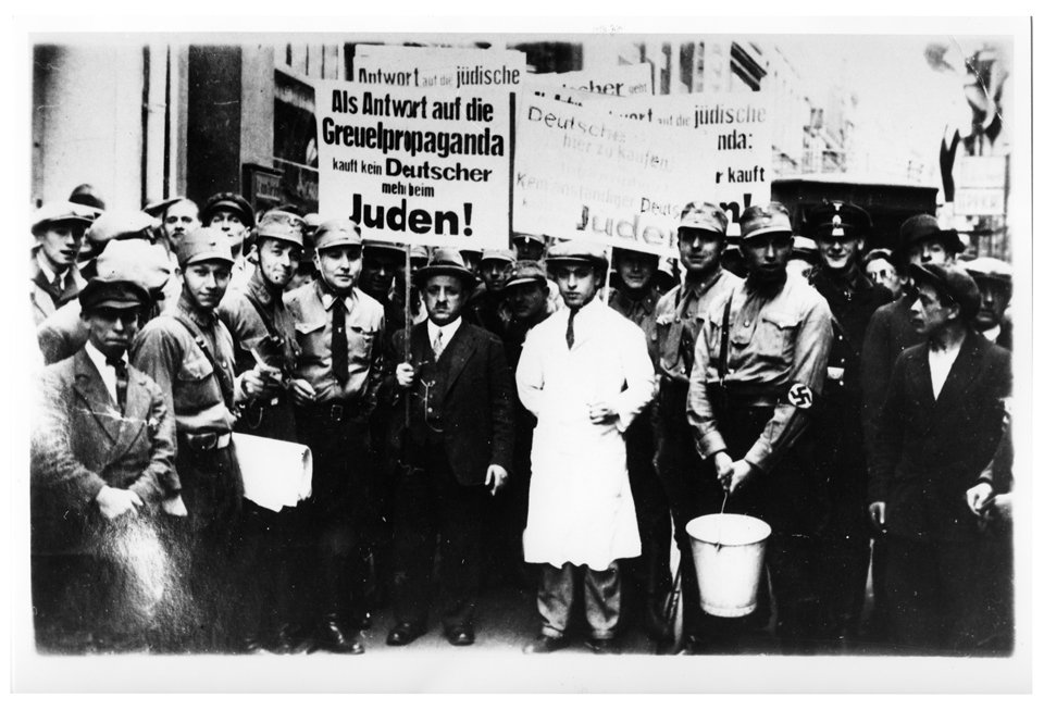 Arnold Katz and his son Benno Katz being paraded through Cologne during a boycott of Jewish businesses on 1 April 1933