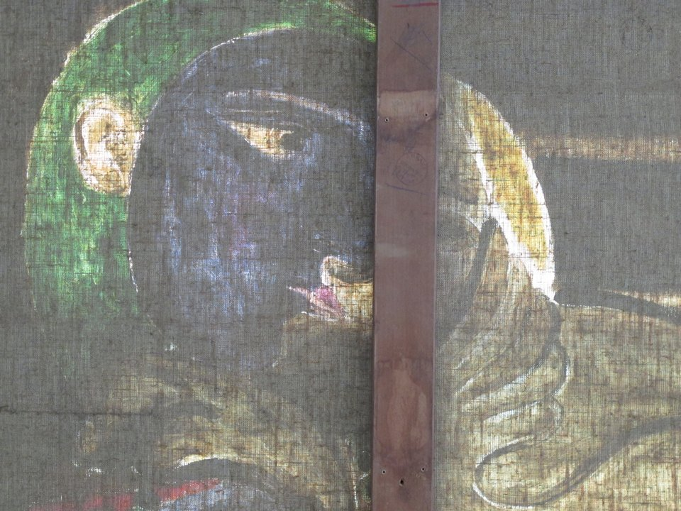 Detail of the woman's face in transmitted light viewed from reverse
