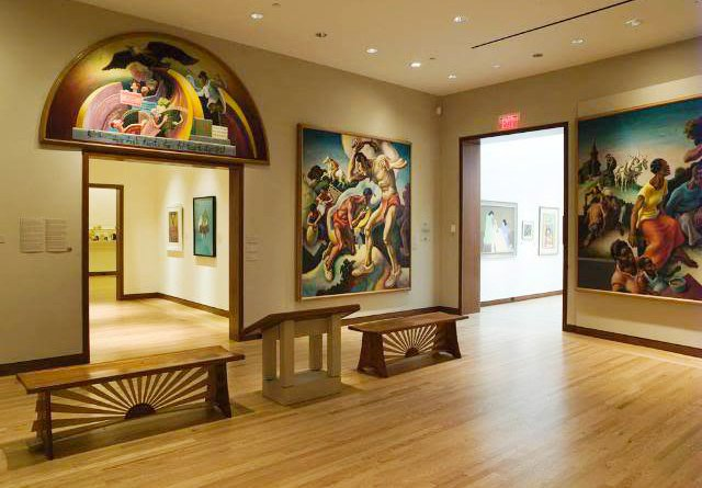 Installation view of panels from Thomas Hart Benton's The Arts of Life in America 1932