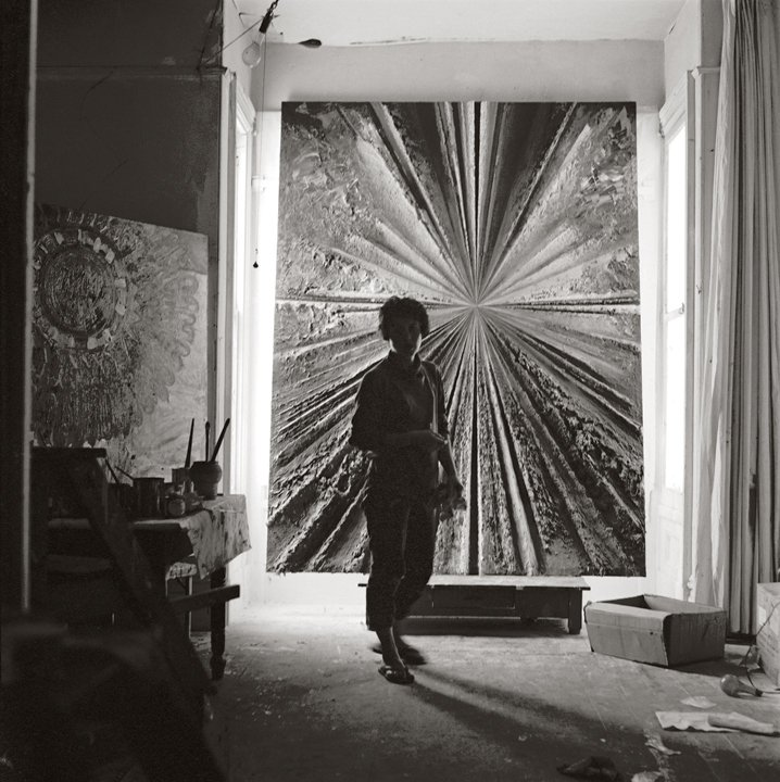 Jay DeFeo standing in front of The Rose at 2322 Fillmore Street, 1959