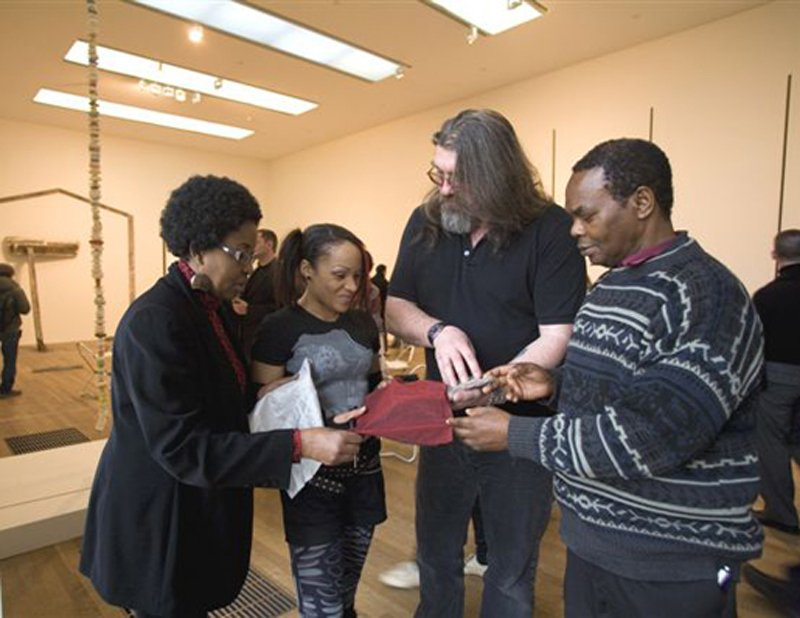 Participants working with an artist during a community education session at Tate Modern