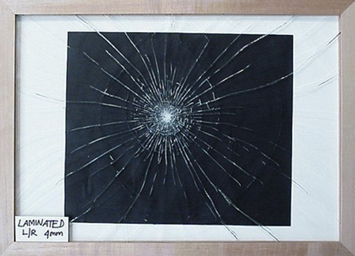 Regular starburst breakage pattern of laminated low reflective glass fitted in frame with window mount