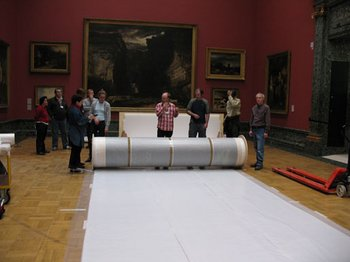 Team of Art Handlers, Conservators and Technicians preparing to unroll the canvas at Tate Britain.
