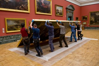 Carefully raising the work on its frame; installing work at Tate Britain
