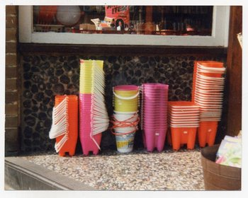 Prunella Clough, photograph of plastic buckets stacked up underneath a shop window, Tate Archive
