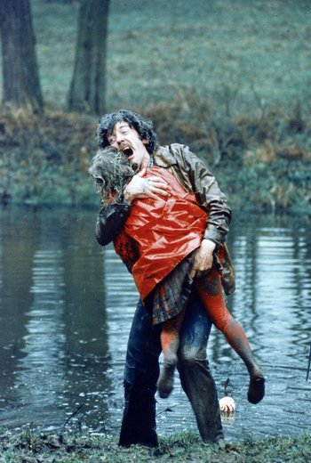 Donald Sutherland clutching his daughter in the red coat in Nicolas Roeg's Don't Look Now, 1973