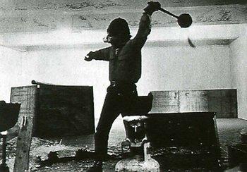 Gianfranco Gorgoni, Richard Serra throwing lead at Leo Castelli's warehouse, New York, 1969