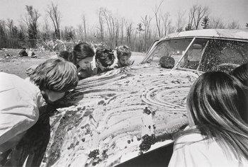 Sol Goldberg photograph of participants in Allan Kaprow Women licking jam off a car