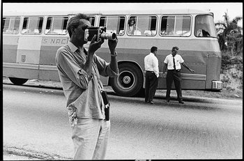 Photograph of Wifredo Lam filming during a tour of Cuba