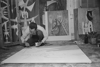 Photography of Wifredo Lam in his studio in Havana