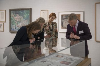 Patrons look at works in the Tate Archive