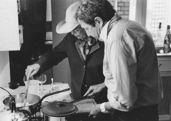 Robert Rauschenberg and Teeny Duchamp fixing lunch at Christophe de Menil's apartment in Paris, April 1981