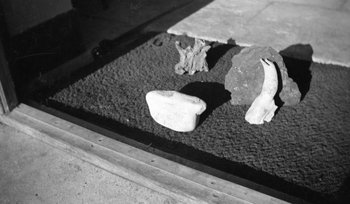 Paul Nash, Black and white negative, still life flints on a doormat date not known