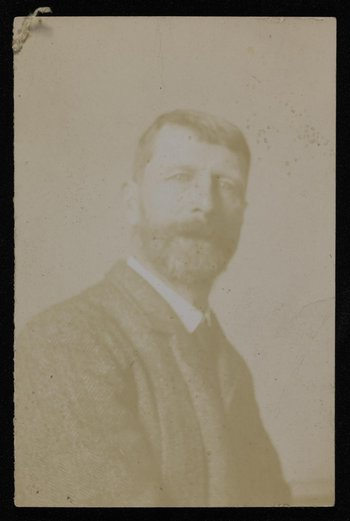 A black and white portrait photograph of Thomas Cooper-Gotch
