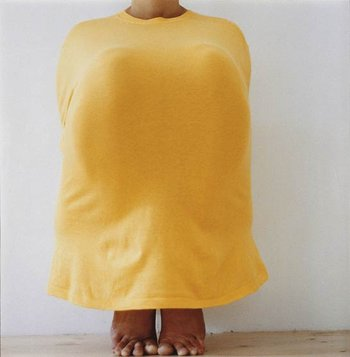 Erwin Wurm Untitled (Thalidomide) 04 1998 (squatted model in yellow tshirt, arms hidden behind and knees under tshirt)