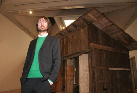 Simon Starling with Shedboatshed (Mobile Architecture No 2), after receiving the 2005 prize