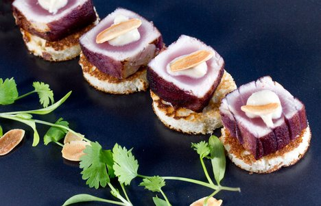 Red wine tuna with shallots on a pure almond blini one of the dishes available at events hosted by Tate's hospitality team