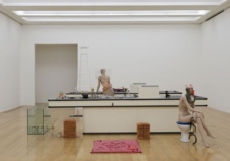 Cathy Wilkes I Give you All My Money 2008 installation view of mannequins positioned around kitchen sink units