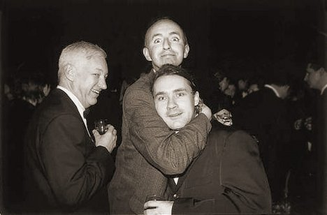 Damien Hirst (right) at the Tate after receiving the Turner Prize with artists Michael Craig-Martin (left) and Grenville Davey (centre), 1995