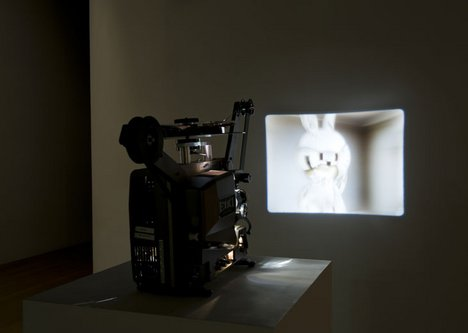 Installation view of Turner Prize 2008 featuring Mark Leckey Made in Eaven image of rabbit like toy being projected on to a wall