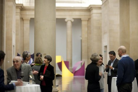 Patrons enjoy a drinks reception in Tate Britain's Phillip King display