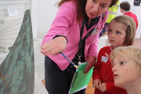 Teacher and pupils looking at Barbara Hepworth Stringed Figure (Curlew), Version II 1956, edition 1959 at Tate St Ives