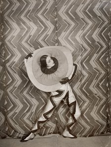 wearing the Pierrot-Éclair costume designed by Sonia Delaunay, on the set of René Le Somptier's film Le P'tit Parigot 1926