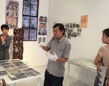 Koh Nguang How 'performing' his archive at Nanyang Technological University's Centre for Contemporary Art, Singapore, October 2014