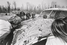 Sol Goldberg photograph of participants in Allan Kaprow Women licking jam off a car