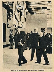 Page from Triunfo magazine 8 June 1974 showing the Minister for Cultural Affairs Alain Peyrefitte walking under a Burnt Canvas with collector Aime Maeght and Joan Miro at the artists retrospective