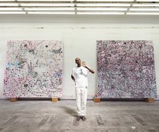 Mark Bradford in his studio in Florence, South Central Los Angeles, 2015, photographed by Jason Schmidt